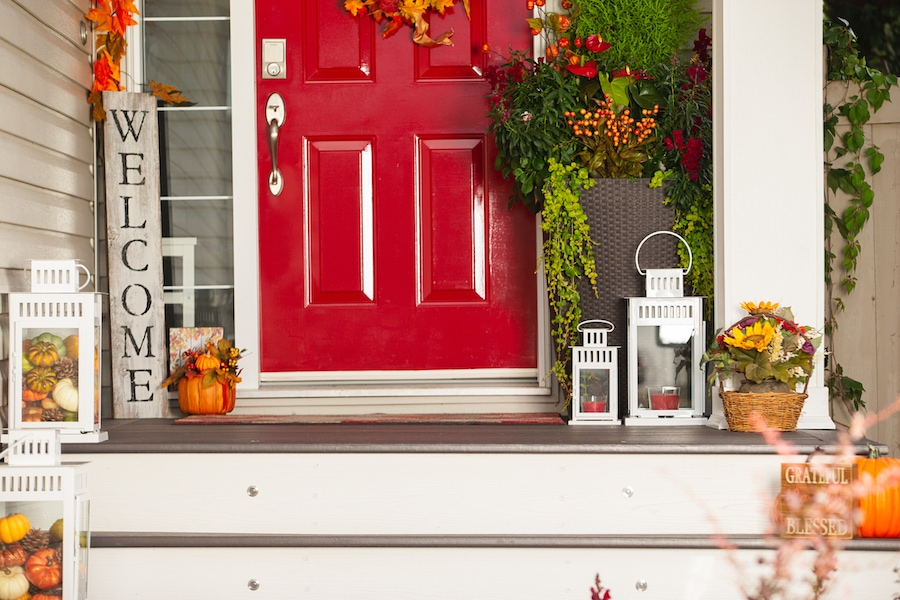 Front door decorations during the fall season showing the benefits of getting fall HVAC maintenance.