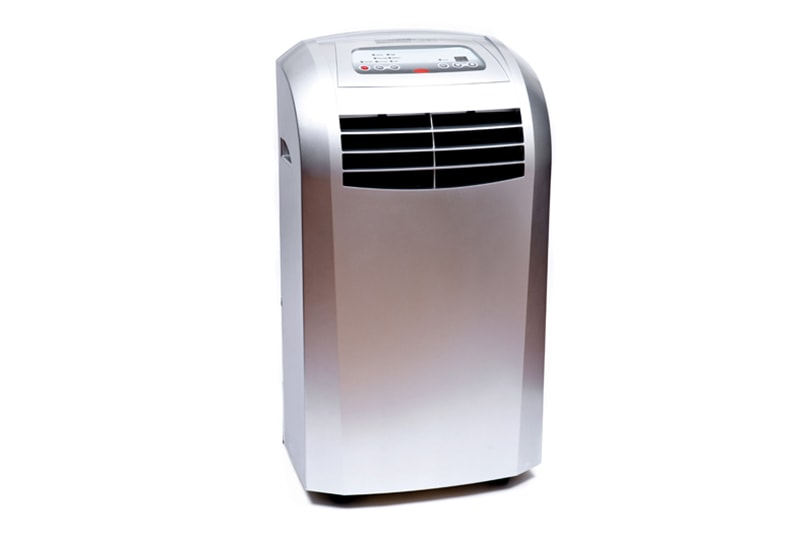 Medium room portable home dehumidifier single hose air conditioner with window mounting kit isolated on white background